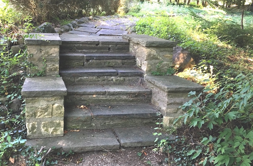 Stone staircase to a flagstone pathway